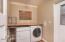 Large inside laundry room with original Milk Box!
