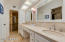 Remodeled master bathroom with solid limestone counters, new hardware, fixtures, toilet and lighting.