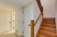 Master Wood Craftsman created custom stair railing and cedar lined closet under the stairs.