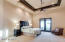 Spacious Master Suite with Private patio & Custom Ceilings