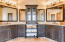 Gorgeous cusom cabinets and mirrors.