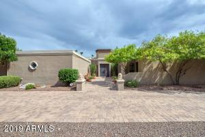 This stunning home sits on over 3/4 of an acre in a gated community at the base of Phoenix Mountain Preserve. Interior features include 4 bedrooms and an office/den, 5.5 bathrooms, two spacious living areas, gourmet kitchen with Dacor appliances, game room with a kitchenette and bar, basement with a fitness room, and a 5,000 bottle wine cellar with a tasting room. There is even a second, smaller wine room tucked away upstairs! Outside, you can enjoy private tennis & basketball courts, putting green, sparkling pool, direct hiking trail access and incredible mountain views in every direction! Lofty hedges border the property to offer privacy and a peaceful vibe. You must see this home and all it has to offer in person!
