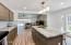 Spacious kitchen w/expansive countertops & island