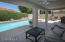 lengthy covered patio is perfect for pool side lunch!