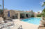 Play by day and enjoy the sun, easy views of pool right from kitchen and dining!