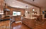 Kitchen faces south to beautiful mountain views and large grassy yard and pool.