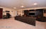 This media room was formerly a two car garage and could easily be converted back to parking.