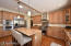 Kitchen is warm and updated with granite counters, under cabinet lighting, walk in pantry, gas range and eat-in dining.