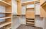 Master closet with custom shelving.