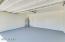 Fresh, clean, new epoxy coating on the garage floor.