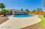 Lot is 8K sf. Huge pool with grassy play area, lush palm trees, fruit trees, granite, and new fencing completes the look!