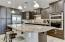 Upgraded soft-close kitchen cabinetry - Stainless appliances- Granite countertops
