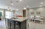 Over sized kitchen island with stainless farmers sink & dishwasher