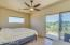 Master Bedroom, sliding door to pool and back patio.