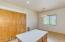 Tall ceilings, built-in pantry, center island, Corian counters.