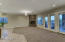Another view of the living room with brand new c arpet