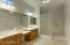 Master bath with double sinks, vanity area and glass block shower!