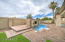 Beautiful backyard, with a play pool with built-in fire pit, and grass area to play!