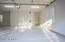 3 car garage with Epoxy flooring, private storage and workshop