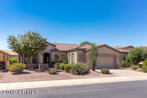 Beautiful curb appeal with easy to maintain desert landscape yard.