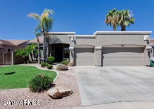 This stunning home is nestled between the heart of Downtown Gilbert and SanTan Village, situated just two miles from the Loop 202 SanTan Freeway. You'll love its wonderful curb appeal, three car garage with new garage doors, thoughtful upgrades, and fabulous backyard with built-in BBQ grill, outdoor fireplace, and sparkling pool. With an open floor plan and lofty ceilings, this home offers plenty of natural light and an inviting ambiance. The upgraded kitchen features shaker cabinets, granite counter tops, American Standard sink, and stainless GE appliances, all flowing nicely into the spacious family room, complete with a gas fireplace and engineered wood flooring. You'll love the crown molding and remodeled bathrooms! Schedule your showing today before it's gone!
