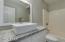 Master en suite bathroom with vessel sink and granite.