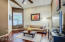 Beautiful den/office with wood flooring