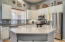 Updated kitchen includes; refinished cabinets, countertops, fixtures and ss appliances