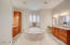 Luxurious master bathroom offers a soaking tub, his and her vanities and a snail shower. His and her walk in closets great you as you enter the Master Bathroom Hallway.