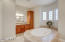 Luxurious master bathroom offers a soaking tub, his and her vanities and a snail shower