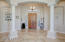 Beautiful grand entrance with 12 foot ceilings, neutral tile and paint throughout the home.