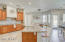 The elegant kitchen boasts granite counters, stainless steel appliances, walk in pantry and island complete with breakfast bar