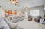 Great room is adjacent to the kitchen/dining areas, perfect for entertaining