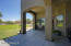 spacious covered patio to overlook the yard and entertain