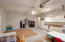 Double garage is air conditioned, with built in kitchenette and epoxy floors and an entrance into the 3rd car garage.