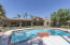 Covered patio and full size diving pool perfect for entertaining
