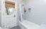 Modern subway tiles and a door leading to backyard and outdoor shower