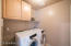 Laundry with built-in cabinets