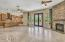 Open floor plan leads to designer Colletti doors to the backyard Oasis