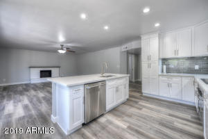 Great Room, beautiful flooring, recently installed cabinets and appliances.