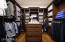 Beautiful custom closet with a variety of storage options