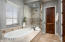 Soaking tub, step-in shower, linen closet