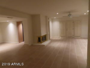 Dining Room on Left and Family Room with New Tile Floor, Fans, Recessed Lighting, FP