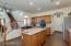 Kitchen features granite countertops and classic backsplash