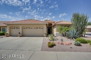 This lovely and well-maintained home is nestled on a N/S facing corner lot in the guard-gated 55+ community of Arizona Traditions.