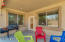 views of the backyard form kitchen and living room