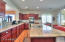 Over sized kitchen with gorgeous huge granite island eating bar.