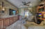 Highlighted are the built in cabinets and stacked stone wall.
