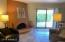 Great room with kiva fireplace, sliding glass door to patio