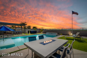 Amazing sunsets with south mountain off in the distance and no homes behind you. Sun shades are high quality and already installed at bbq / pizza oven patio and wall of glass door. Interior shades at wall of glass door are electronic and can be moved independently in 3 different sections with a push of a button.